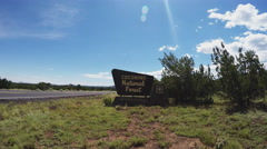 Camera Moves Toward Coconino National Forest Sign- Flagstaff Arizona Stock Footage