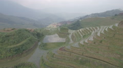 Agriculture and tourism in China, aerial drone view of Longji rice terraces Stock Footage