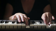 Woman hand playing a MIDI controller keyboard synthesizer close up. Stock Footage
