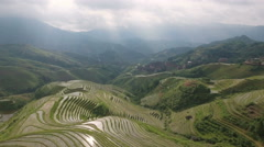 Aerial view stunning mountain panorama green rice terraced fields China Asia Stock Footage
