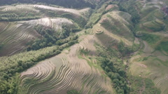 Beautiful aerial view of terraced rice paddy fields in rural China Stock Footage