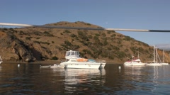 Yachts moored in Catalina cove in the morning with the dry parched hills in t Stock Footage