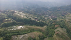 Scenic terraced rice paddy fields seen from the air in rural China Stock Footage