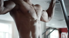 Man execute pull ups in gym Stock Footage