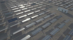 Reflection on solar panels in Chinese desert, aerial drone perspective Stock Footage