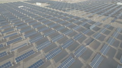 Drone flight over solar panels in desert landscape, sustainability in China Stock Footage