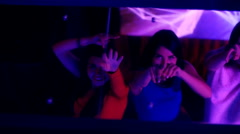 Beautiful girls dancing at a party - in the reflection of the mirror Stock Footage