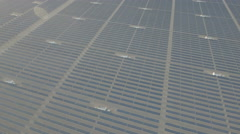 Aerial panning shot of huge solar panel fields in barren deserts China Stock Footage