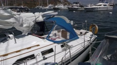 View of sailboat tied to side of another boat moving with the waves in Catali Stock Footage