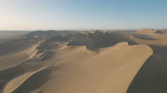 Beautiful aerial drone shot of massive mountainous sand dunes in desert China Stock Footage