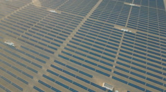Aerial view of photovoltaic units, solar panels in arid desert landscape China Stock Footage