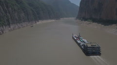 Barge ferry sails through Three Gorges on Yangtze River China Stock Footage
