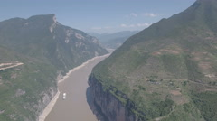 High angle aerial drone view cruise ship sailing through Three Gorges in China Stock Footage