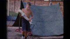 1968: boy removing hot pot from campfire COTTONWOOD, ARIZONA Stock Footage