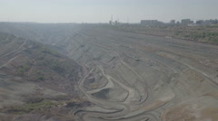 Aerial view of open coal mine pit in Liaoning province, China Stock Footage