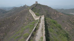 Flying over decayed part of Great Wall of China Stock Footage