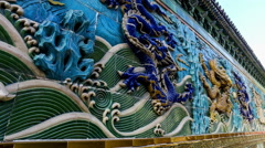 Close-up seeing the Nine Dragons Screen in Beihai Park, Beijing, China Stock Footage