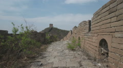 Hiking over a beautiful decaying overgrown stretch of the Great Wall of China Stock Footage
