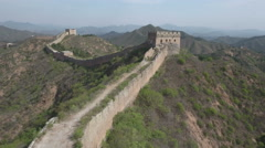 Retreating aerial view of crumbling decayed part of Great Wall of China Stock Footage