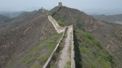 Flying over a quiet decayed stretch of the Great Wall of China Stock Footage