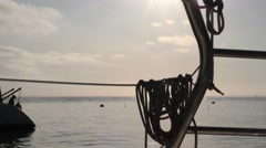 Ropes on boat in early morning sun in Catalina mooring balls can be seen Stock Footage