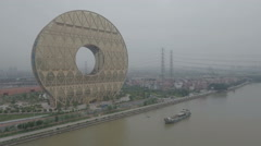 Aerial view of the golden colored Guangzhou Circle in China Stock Footage
