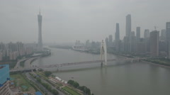 Aerial view of business district and Canton tower, smog air pollution China Stock Footage