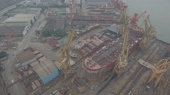 Aerial slider shot of old shipyard, crisis economic downturn China Stock Footage