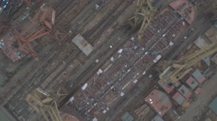 Overhead aerial view of old shipyard in China, oversupply crisis slowdown Stock Footage
