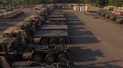 Flyover Military Depot Flatbed Trucks Stock Footage