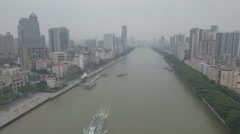 Retreating aerial shot of the skyline of Guangzhou, China Stock Footage