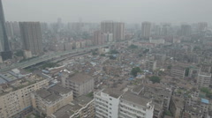Aerial view of old houses and new apartment buildings in Guangzhou Stock Footage