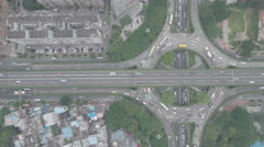 Overherad aerial view of roundabout and highway in Guangzhou China Stock Footage