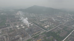 Flying backwards from a huge oil refinery, heavy industry in China Stock Footage