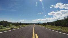 POV Walking Down Center Of Highway 180 Toward Flagstaff Arizona Stock Footage