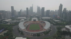 Panning aerial view of the stadium of the Guangzhou Evergrande Football Club Stock Footage