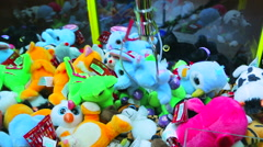 Catching toys in the street grabbing machine. Claw machine full of toys Stock Footage