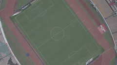 Aerial rise up of the Guangzhou Evergrande football club stadium in China Stock Footage