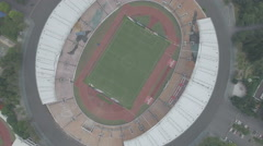 Aerial view of Guangzhou Evergrande Football club stadium in China Stock Footage