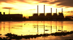 Electric power plant at sunset Stock Footage