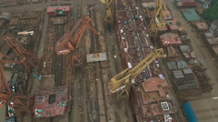 Aerial view of a massive industrial shipyard in China Stock Footage