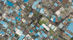 Overhead aerial view of rooftops congested residential neighborhood China Stock Footage