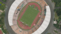 Overhead aerial view of a sports stadium (football, soccer) in China Stock Footage