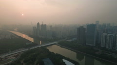 Aerial drone view of hazy sunset over Guangzhou city China Stock Footage