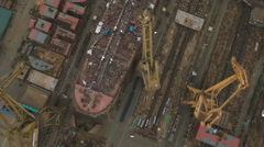 Overhead aerial shot of old rusty shipyard, heavy industry China Stock Footage