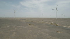 Aerial drone shot of wind turbines in massive industrial park in deserts China Stock Footage
