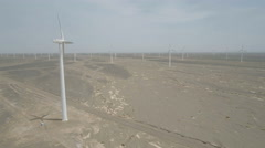 High angle drone shot of massive wind energy power station in China Stock Footage