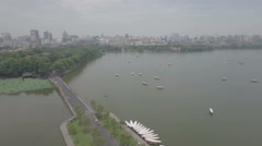 High angle aerial drone flight over West Lake and Hangzhou skyline Stock Footage