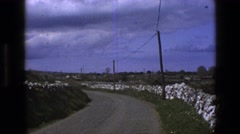 1969: country scene with winding road and cows in fields IRELAND Stock Footage