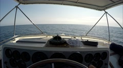 POV shot of driving two story motor yacht in open sea on sunny day. Stock Footage
